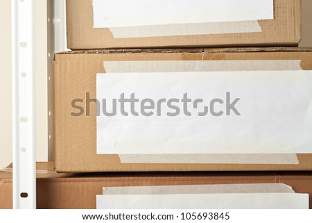 Cardboard boxes with blank labels. Moving, storage concept.