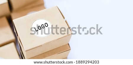 Cardboard brown box or Craft package box isolated top view on white background.Online delivery service, Food box delivery for food delivery application.mockup empty box for logo and brand concept