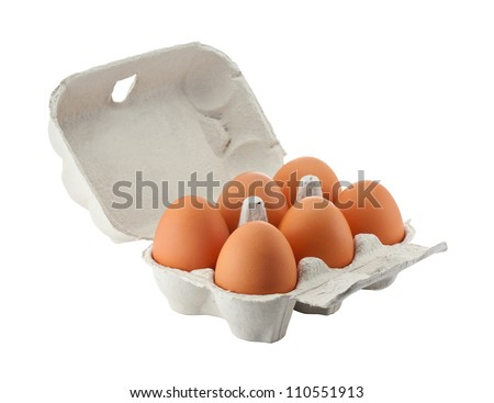 Cardboard egg box with six brown eggs isolated with clipping path