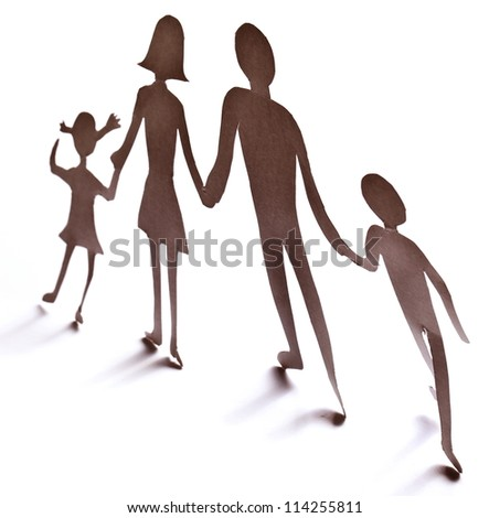 Cardboard figures of the family on a white background. The symbol of unity and happiness.