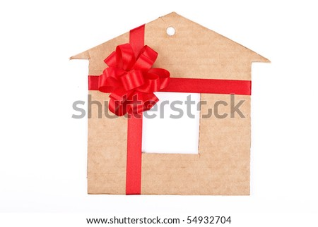 Cardboard house with red ribbon and bow