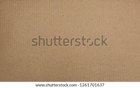 Cardboard paper background. Textural background for design.
