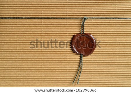 Cardboard paper background with sealing wax