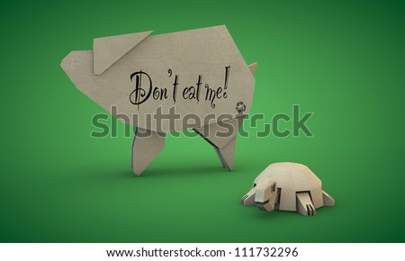 cardboard shaped like a pig and tortoise isolated on green background