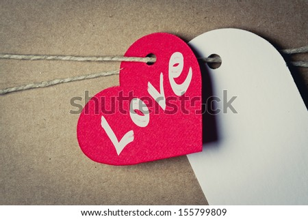 cardboard tag heart shaped red with love word