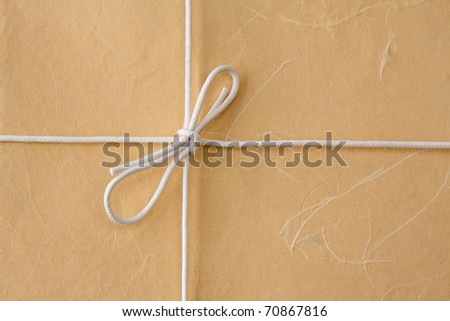cardboard tag with bow isolated on white background