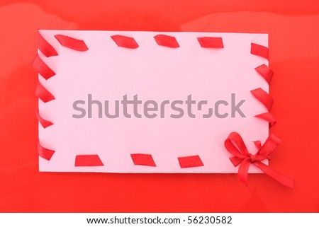 cardboard tags with red ribbon bow  on red