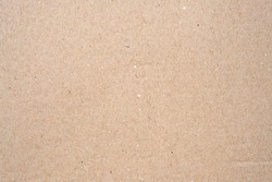 Cardboard texture top view. Brown paper background close-up. Paper texture brown sheet absrtact background. Light brown wrapping texture.