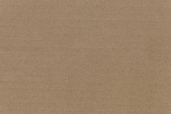 Cardboard texture top view. Brown paper background closeup. Paper texture brown sheet absrtact background. Light brown wrapping texture