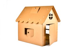 Cardboard toy house for children on white background. Eco-friendly Box for pet or carton playhouse