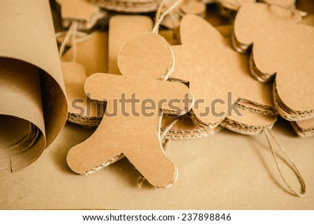 Cardboard toys for the Christmas tree or Christmas garland. Christmas decorations. Selective Focus