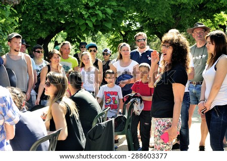CARDET, FRANCE - MAY 25: Treasure hunt organized in a French campsite to amuse and occupy campers. The instructions are given before departure, may 25, 2015.