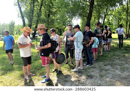CARDET, FRANCE - MAY 25: Treasure hunt organized in a French campsite to amuse and occupy campers. Participants must find the envelopes containing the indices. Verification of answers, may 25, 2015.