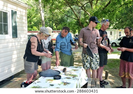 CARDET, FRANCE - MAY 25: Treasure hunt organized in a French campsite to amuse and occupy campers. Participants must find the envelopes containing the indices, may 25, 2015.