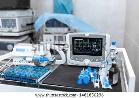 Cardiac monitor and syringe at operating table. Pet surgery. #1481856296
