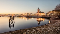 Cardiff Bay sunset, South Wales UK with a clear sky on a cold winter evening.