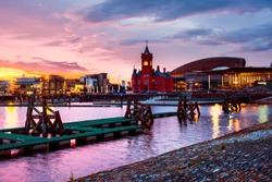 Cardiff, UK. Waterfront at night in Cardiff, UK. Sunset colorful sky with Wales Millennium Center at Cardiff Bay.