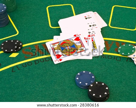 cards and chips at the green table in the casino