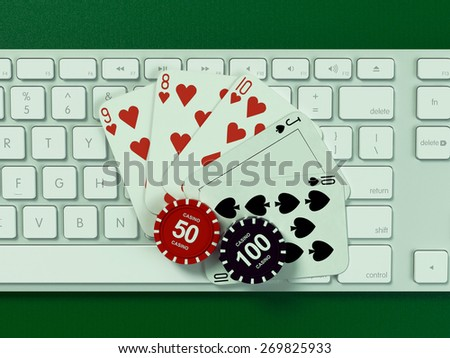 Cards and chips for poker on keyboard.  High resolution.