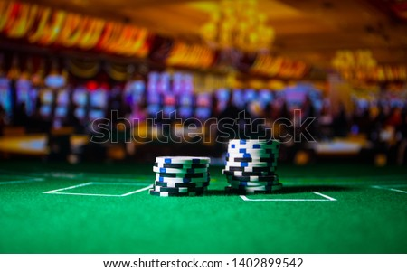 Cards and chips on green felt casino table. Abstract background with copy space. Gambling, poker, casino and cards games theme. Casino elements on green. Selective focus