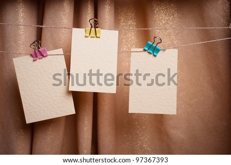 cards on the clothespin on the background of draperies