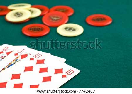 Cards with chips in the background with selective focus