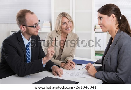 Career and candidate: three people sitting in a job interview for a management position.