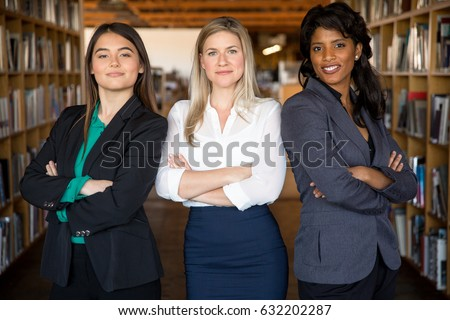 Career business women group looking strong tough and showing confidence with arms folded