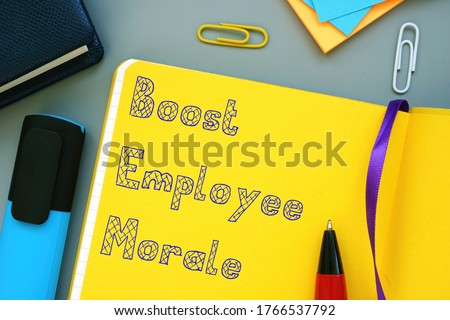Career concept about Boost Employee Morale with phrase on the sheet. Foto d'archivio ©