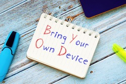 Career concept about Bring Your Own Device BYOD Policy with phrase on the piece of paper.