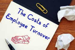 Career concept meaning The Costs of Employee Turnover with sign on the page.