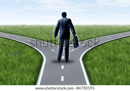 Career decision for a business man at a cross roads showing a fork in the road representing the concept of a work dilemma choosing the direction to go when facing two equal or similar job options.