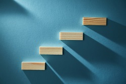 Career development. Step by step. Goal achievement concept. Wooden stairs symbolize growth. Increasing order of blocks