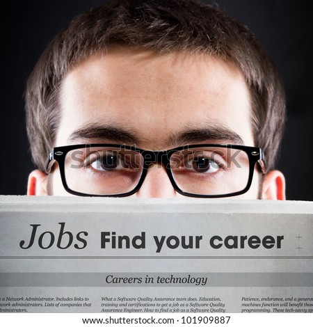 Career News. Young adult looking for daily news.