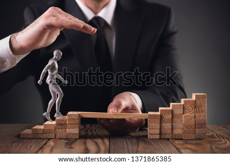 Career Planning Concept. Businessman Getting Help Achieving Goals. #1371865385