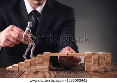 Career Planning Concept. Businessman Getting Help Achieving Goals. #1385092442