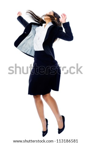 Carefree celebrating businesswoman jumping with joy, victory and happiness while smiling in a suit isolated on white background