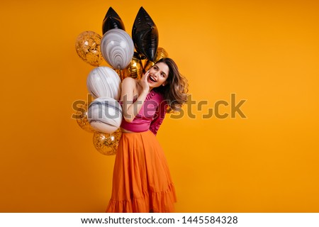 Carefree girl waiting for party. Lovely brunette woman celebrating birthday.