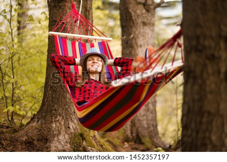 Carefree happy woman lying on hammock enjoying harmony with nature. Freedom. Enjoyment. Relaxing in forest. Daydreaming #1452357197