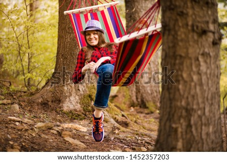 Carefree happy woman lying on hammock enjoying harmony with nature. Freedom. Enjoyment. Relaxing in forest. Daydreaming #1452357203