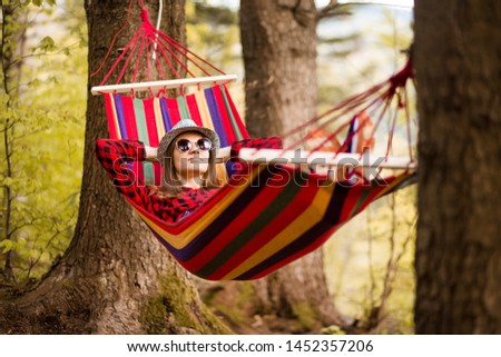 Carefree happy woman lying on hammock enjoying harmony with nature. Freedom. Enjoyment. Relaxing in forest. Daydreaming #1452357206