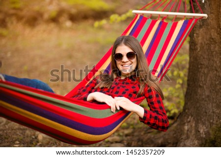 Carefree happy woman lying on hammock enjoying harmony with nature. Freedom. Enjoyment. Relaxing in forest. Daydreaming #1452357209