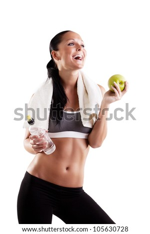carefree healthy woman with apple and water smiling with cheerful confidence isolated on white