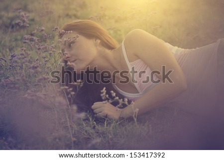 Carefree in nature at sunset. Vintage photo. - stock photo