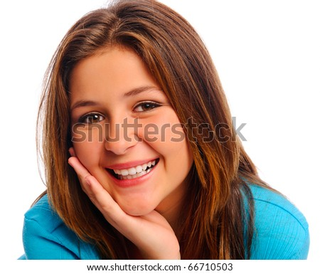 Carefree teenager smiles in studio, isolated on white