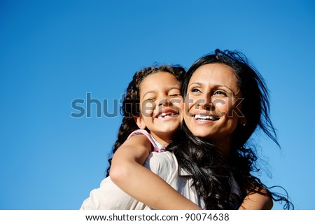 Photo of carefree vitality image of mother and daughter playing together outdoors