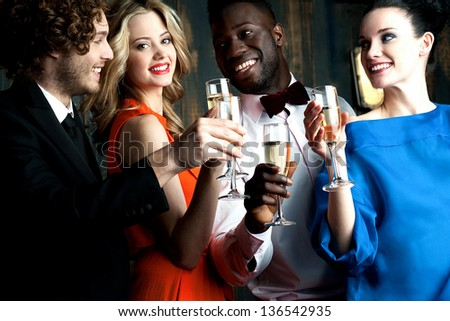 Carefree young couples having cocktails and partying together.