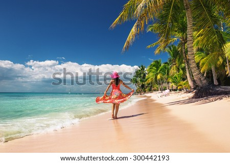 Carefree, Young woman relaxing on the islands beach #300442193