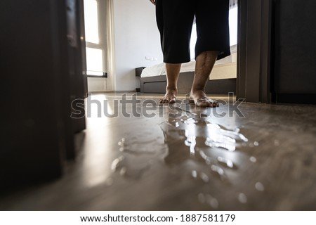 Careful of slippage,danger,accident,asian senior woman is stepping on the wet floor,water spills,old people walking on wet area,risk of slip and fall,concept of prevention and care of the elderly safe Stock photo ©