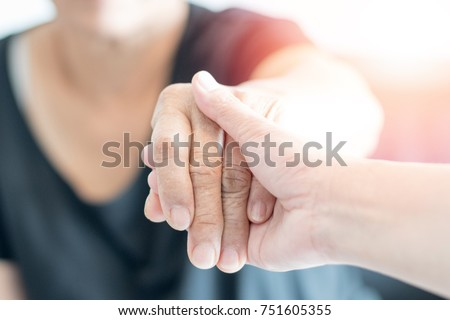 Caregiver, Specialized Assistance, carer hand holding elder hand woman in hospice care. Philanthropy kindness to disabled concept.Public Service Recognition Week Photo stock ©